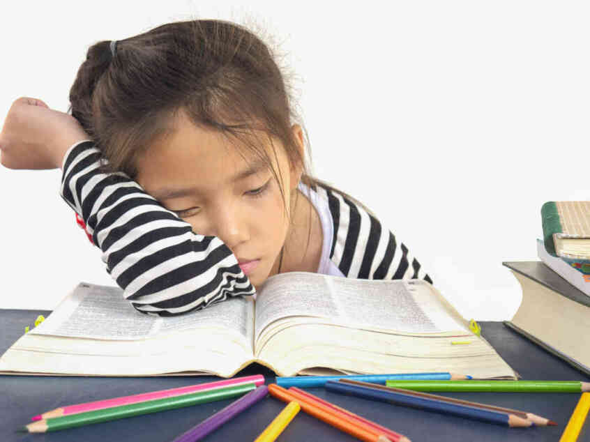young girl sleeping while reading