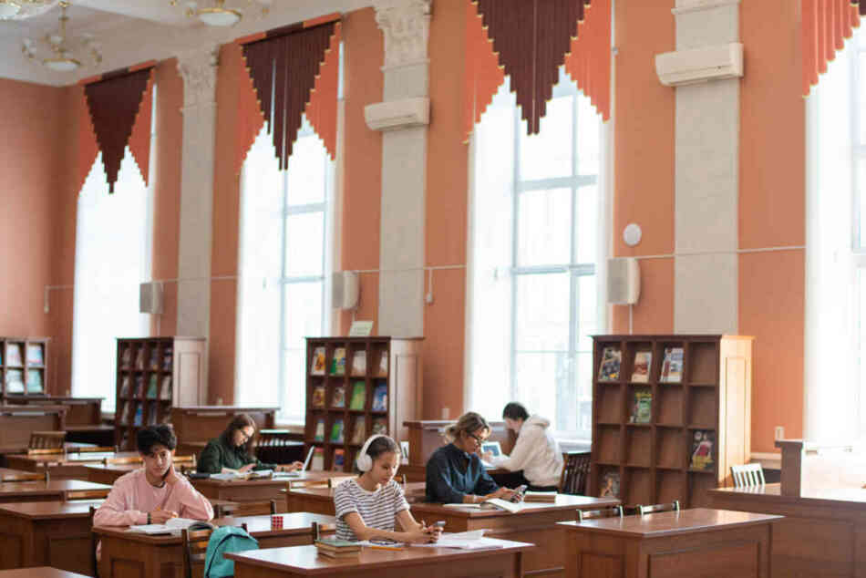 college students in library